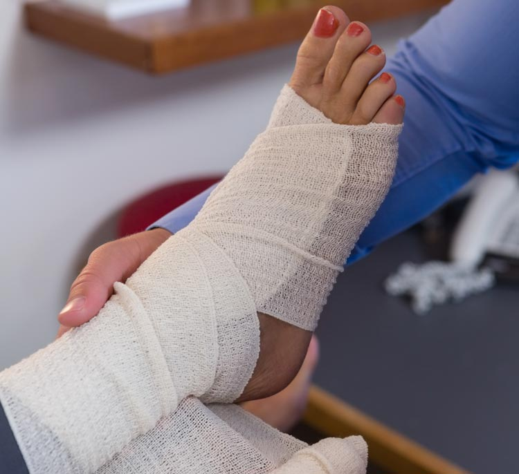 Doctor wrapping a patient's foot and ankle