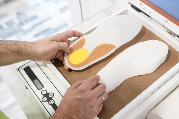 Podiatrist making orthotic insoles